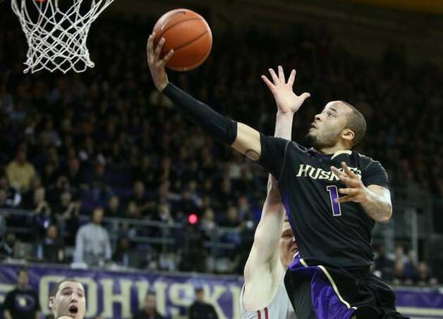 University of Washington Husky Venoy Overton goes up against Washington State University Cougar Charlie Enquist. Photo: Joshua Trujillo, Seattlepi.com