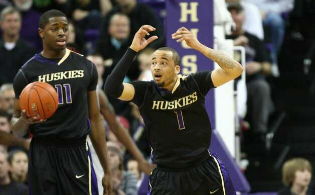 University of Washington Husky Venoy Overton reacts to a call in the second half against Washington State University. Photo: Joshua Trujillo, Seattlepi.com
