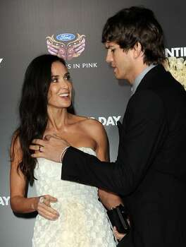 Actress Demi Moore (L) and actor Ashton Kutcher arrive. Photo: Getty Images