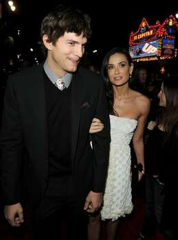 Actor Ashton Kutcher (L) and actress Demi Moore arrive. Photo: Getty Images