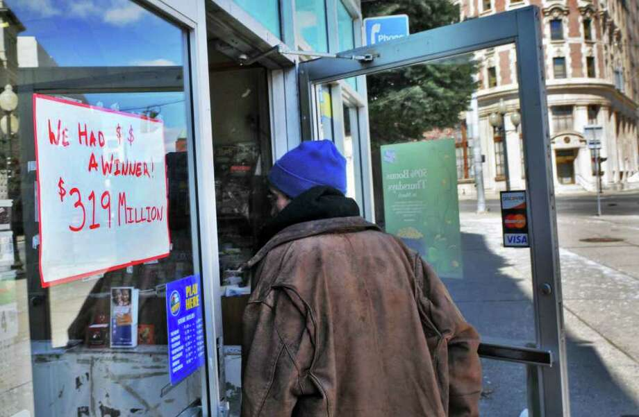 A steady stream of customers coming into Coulson's News Center in downtown Albany Saturday March 26, 2011, where the winning ticket for Friday night's $319 million Mega Millions lottery jackpot was sold.  (John Carl D'Annibale / Times Union) Photo: John Carl D'Annibale