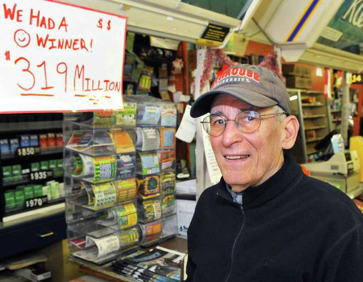 Steve Hutchins, owner of Coulson's News Center in downtown Albany at the counter Saturday March 26, 2011, where the winning ticket for Friday night's $319 million Mega Millions lottery jackpot was sold. (John Carl D'Annibale / Times Union)