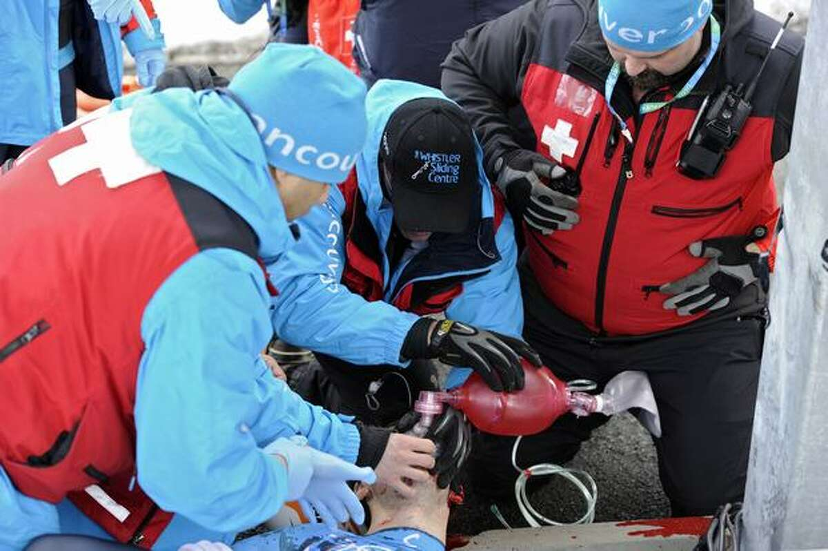 Rescuers try to resuscitate Olympic luge hopeful Nodar Muaritashvili after he crashed during a practice run for the Vancouver Winter Olympics. He was taken to a hospital where he was pronounced dead.