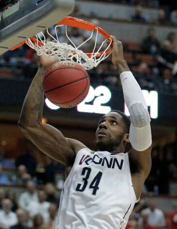 Connecticut's Alex Oriakhi dunks during the second half of the NCAA West regional college basketball championship game, Saturday, March 26, 2011, in Anaheim, Calif.  (AP Photo/Jae C. Hong) Photo: AP