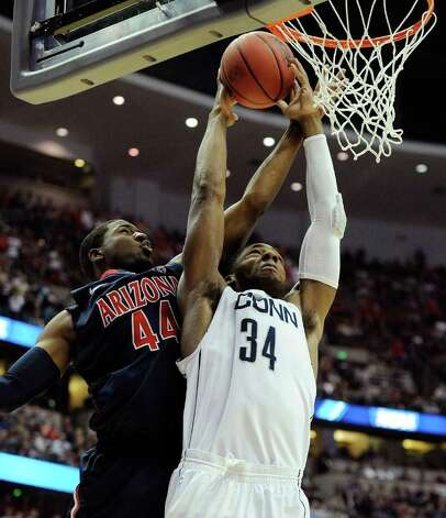 Arizona's Solomon Hill tries to block Connecticut's Alex Oriakhi during the first half of a West regional final game in the NCAA college basketball tournament, Saturday, March 26, 2011, in Anaheim, Calif.  (AP Photo/Mark J. Terrill) Photo: AP