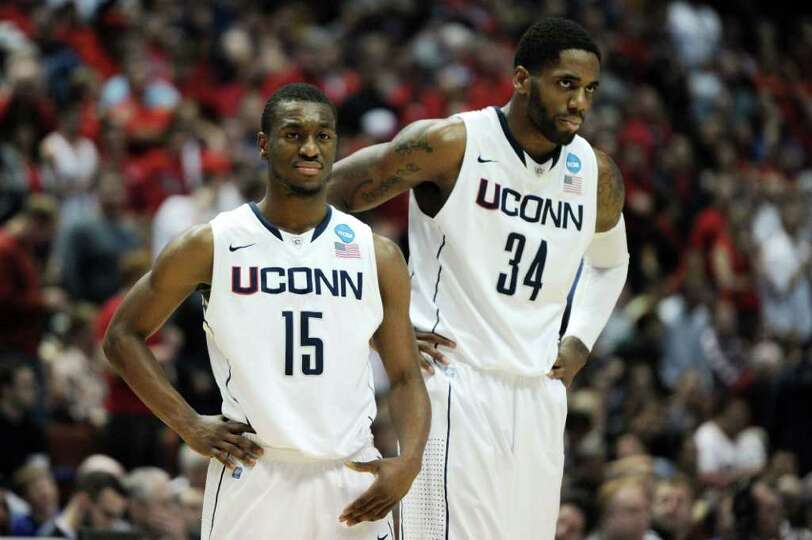 ANAHEIM, CA - MARCH 26:  Kemba Walker #15 and Alex Oriakhi #34 of the Connecticut Huskies look on ag