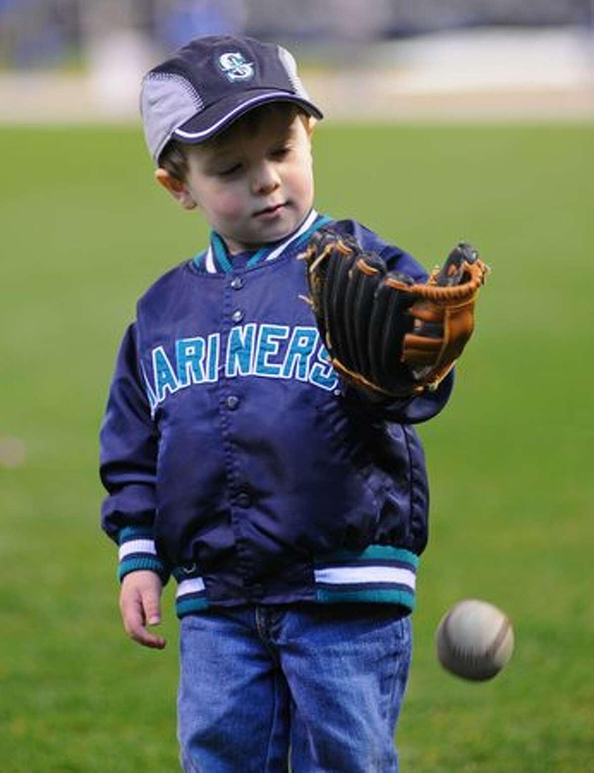 Max Vukelic, 2, plays catch.