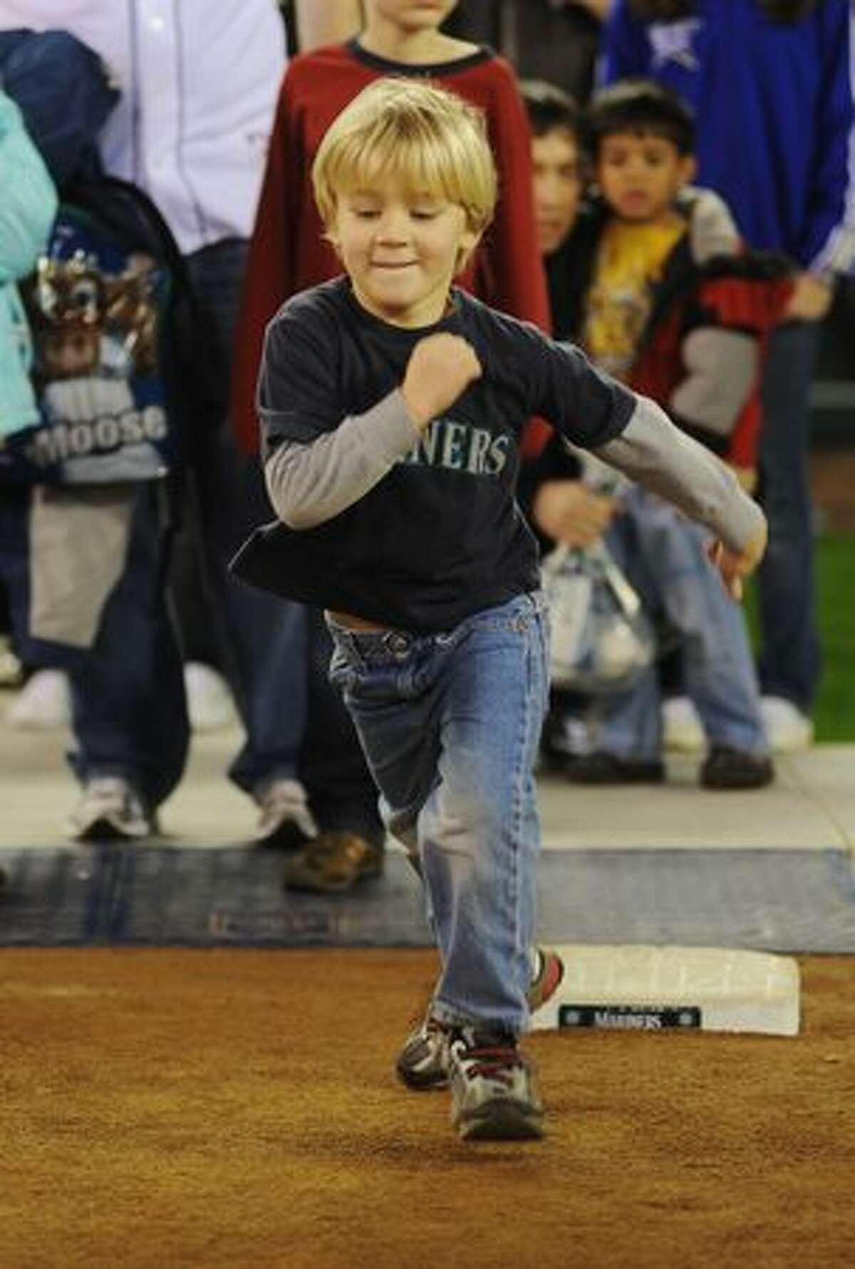 Fedya Henrichs, 5, runs the bases.