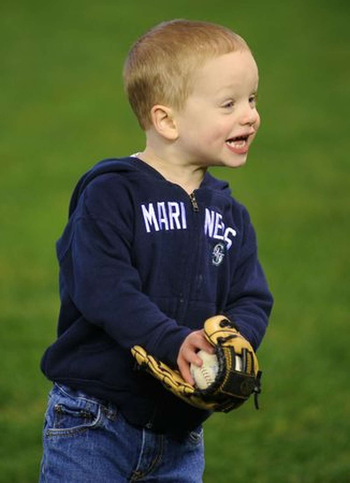 Dylan Clementz, 2, reacts to catching a ball.