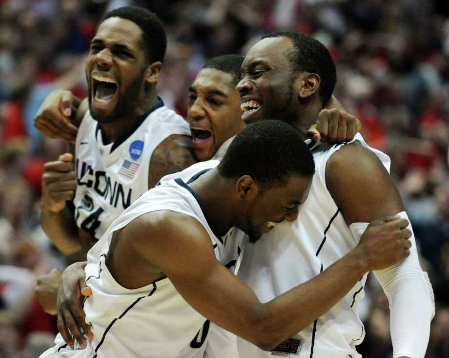 ANAHEIM, CA - MARCH 26:  Kemba Walker #15, Donnell Beverly #2, Roscoe Smith #22 and Alex Oriakhi #34 of the Connecticut Huskies celebrate after defeating the Arizona Wildcats during the west regional final of the 2011 NCAA men's basketball tournament at the Honda Center on March 26, 2011 in Anaheim, California.  (Photo by Harry How/Getty Images) *** Local Caption *** Kemba Walker;Donnell Beverly;Roscoe Smith;Alex Oriakhi Photo: Harry How, Getty Images / 2011 Getty Images