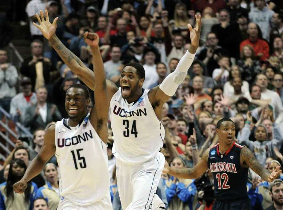ANAHEIM, CA - MARCH 26:  Kemba Walker #15,  and Alex Oriakhi #34 of the Connecticut Huskies celebrate after defeating the Arizona Wildcats as Lamont Jones #12 looks on during the west regional final of the 2011 NCAA men's basketball tournament at the Honda Center on March 26, 2011 in Anaheim, California.  (Photo by Harry How/Getty Images) *** Local Caption *** Kemba Walker;Lamont Jones;Alex Oriakhi Photo: Harry How, Getty Images / 2011 Getty Images