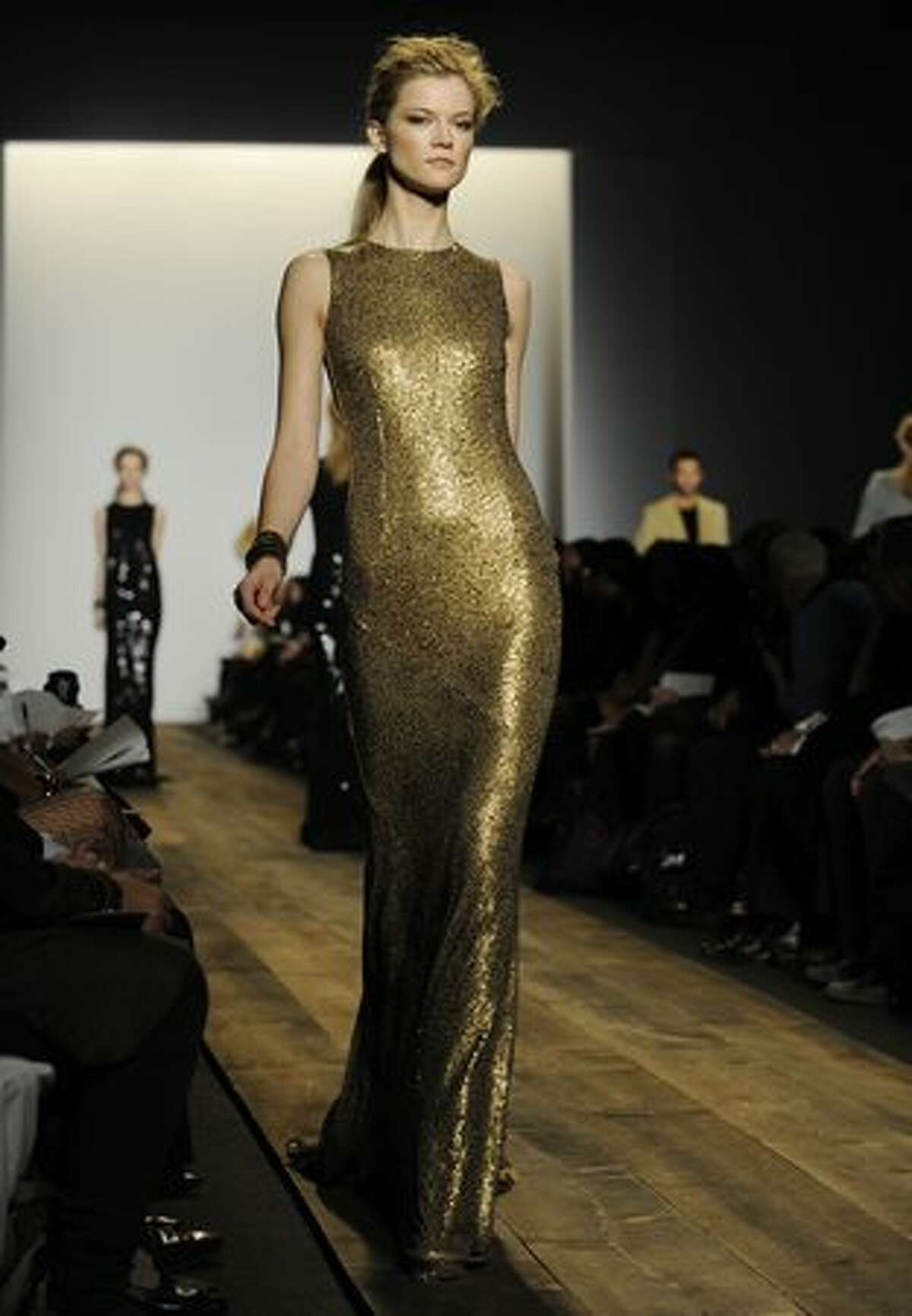 A model displays a creation by Michael Kors.