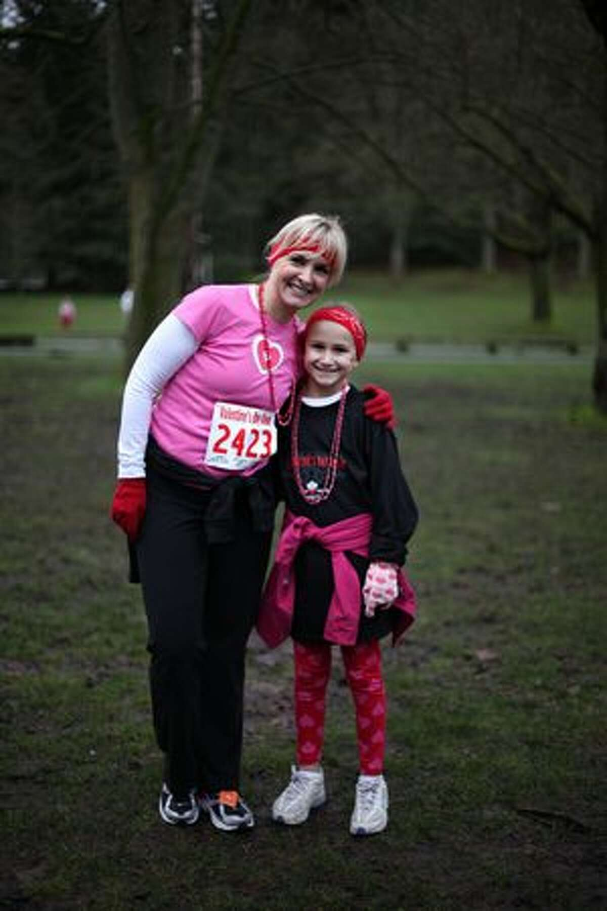 Linda Rackner is pictured with her daughter, Gabrielle, 9, at the Love 'Em or Leave 'Em Valentine's Day Dash in Green Lake on Saturday morning. The 5K run and walk drew approximately 3,000 participants, according to organizers. (David Ryder/seattlepi.com)