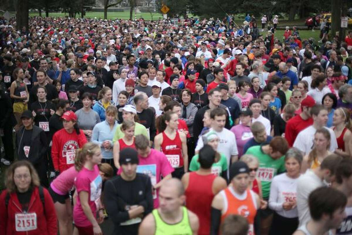 The crowd waits in the starting area on West Green Lake Way N at the Love 'Em or Leave 'Em Valentine's Day Dash in Green Lake on Saturday morning. The 5K run and walk drew approximately 3,000 participants, according to organizers. (David Ryder/seattlepi.com)