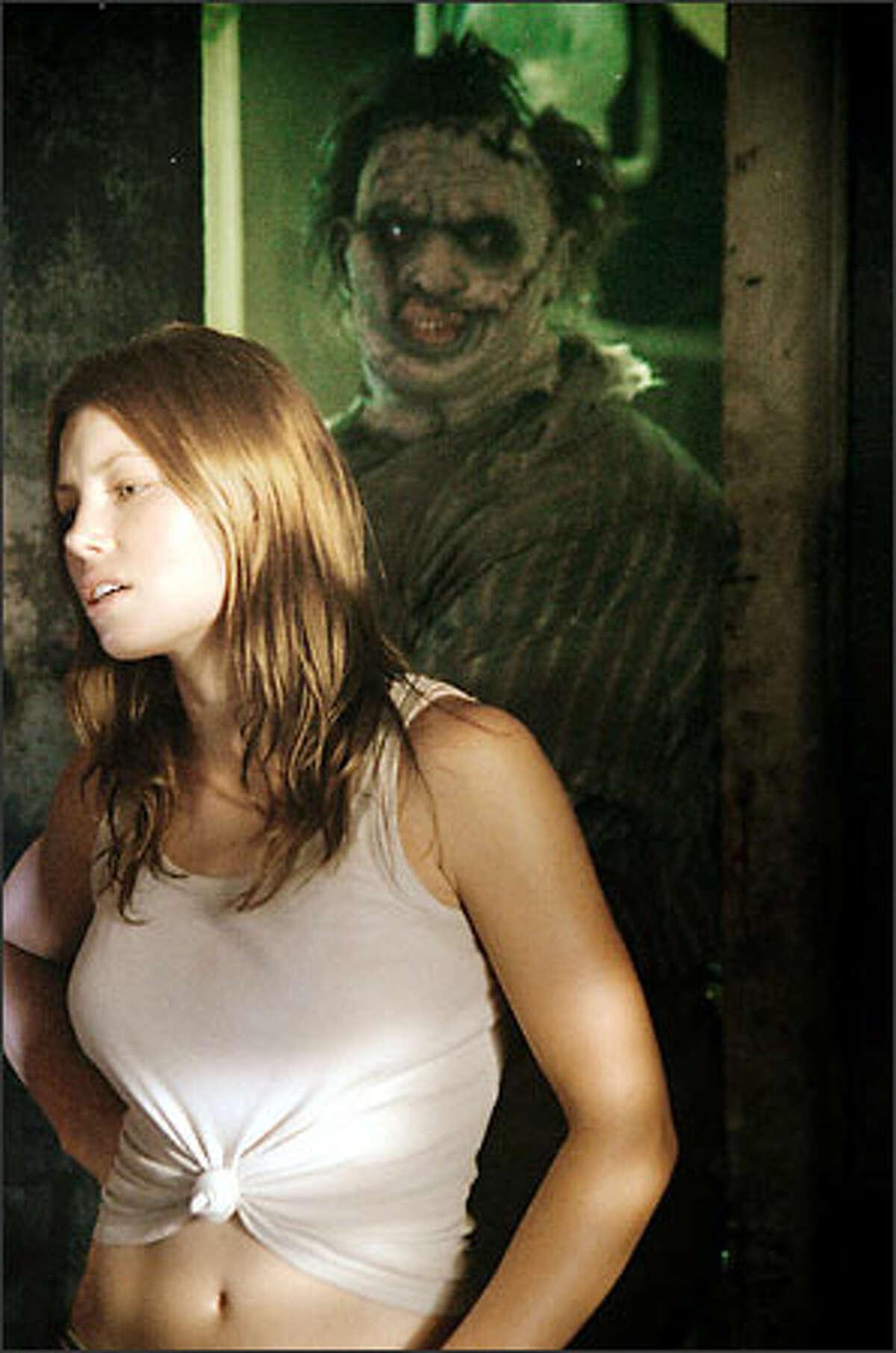 Erin (Jessica Biel) and Leatherface (Andrew Bryniarski).