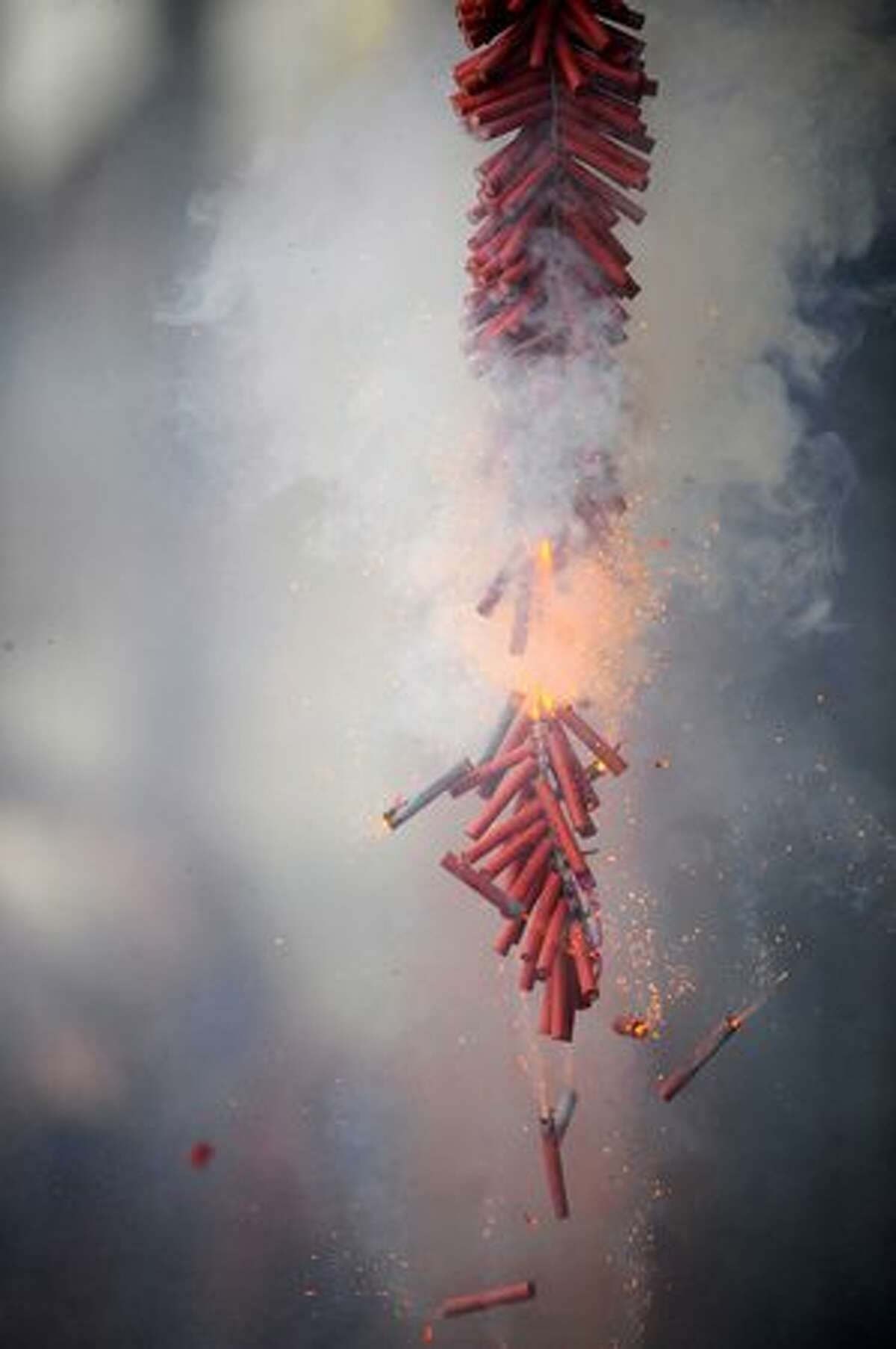 Firecrackers go off during the Lunar New Year celebration in Seattle's International District Feb. 13, 2010.