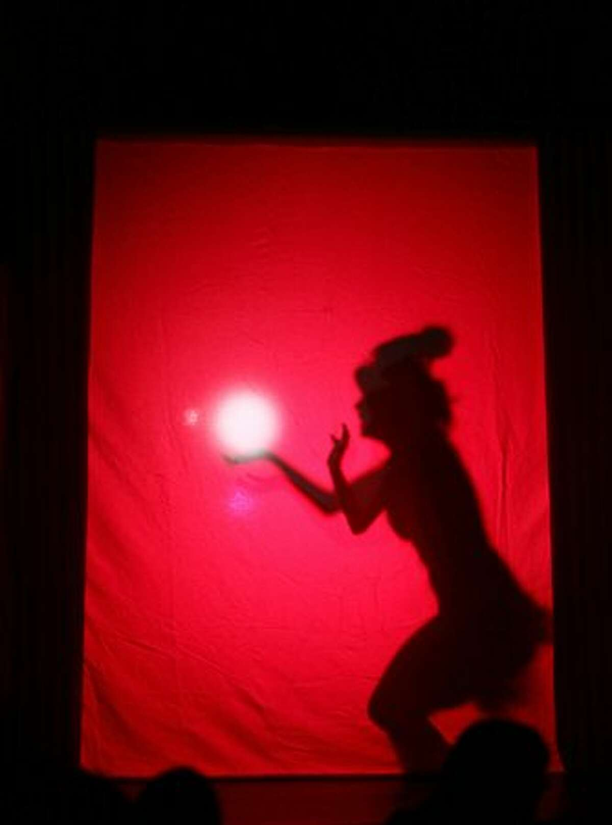 A dancer performs during the show at the Odd Fellows Building, home of the Academy of Burlesque.