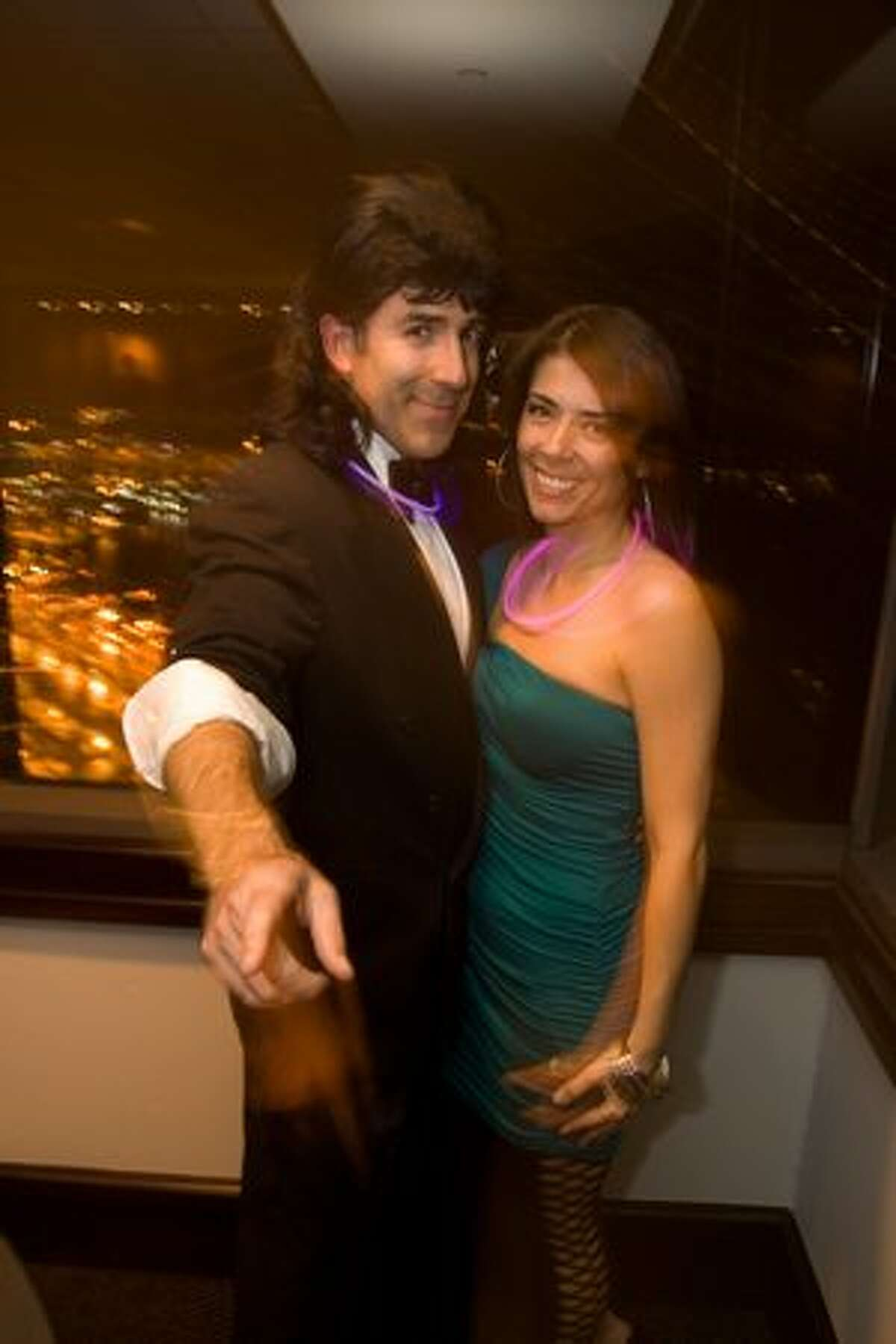 Michael Lee and Stacy Soldo at the '80s Prom Night party at the Columbia Tower Club. (Humberto Martinez / seattlepi.com)