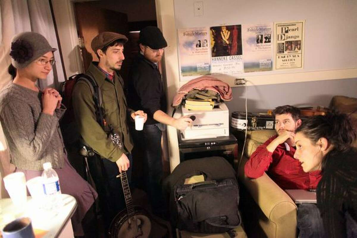 From left, Charmaine Slaven and Charlie Beck of the band Squirrel Butter, and Mark Vaughan, Tim Tweedale and Kathleen Nisbet of Viper Central gather before their respecitve Feb. 26 performances at Empty Sea Studios, a former Phinney Ridge home converted to a music space.