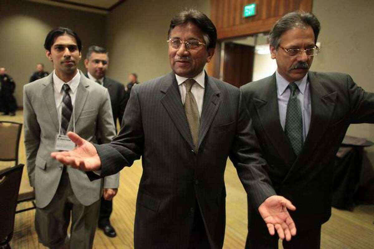 Former President of Pakistan Pervez Musharraf walks into a ballroom at the Bellevue Westin Hotel on Sunday, March 14, 2010. The former president of the Islamic nation spoke for almost an hour and took wide-ranging questions from audience members during a candid question and answer session. Musharraf was an ally of the the U.S. and President George W. Bush in the war on terrorism. Some in Pakistan wonder if the former leader has a place in the political future of that country. He has been living in exile since he was removed from power in 2008. Musharraf's visit to Seattle and Bellevue was sponsored by Friends of Pakistan First.