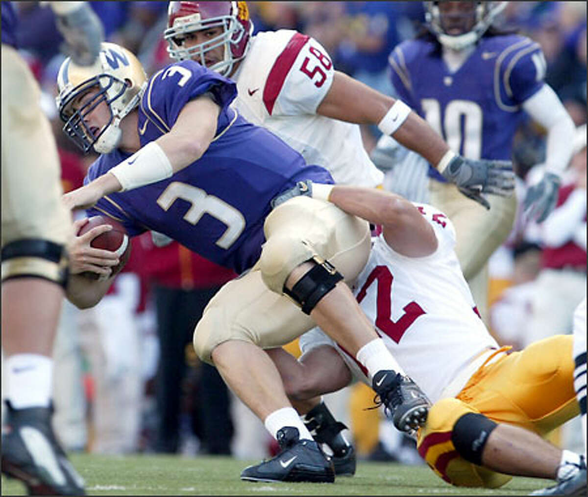 UW's Cody Pickett gets tackled in the first quarter.