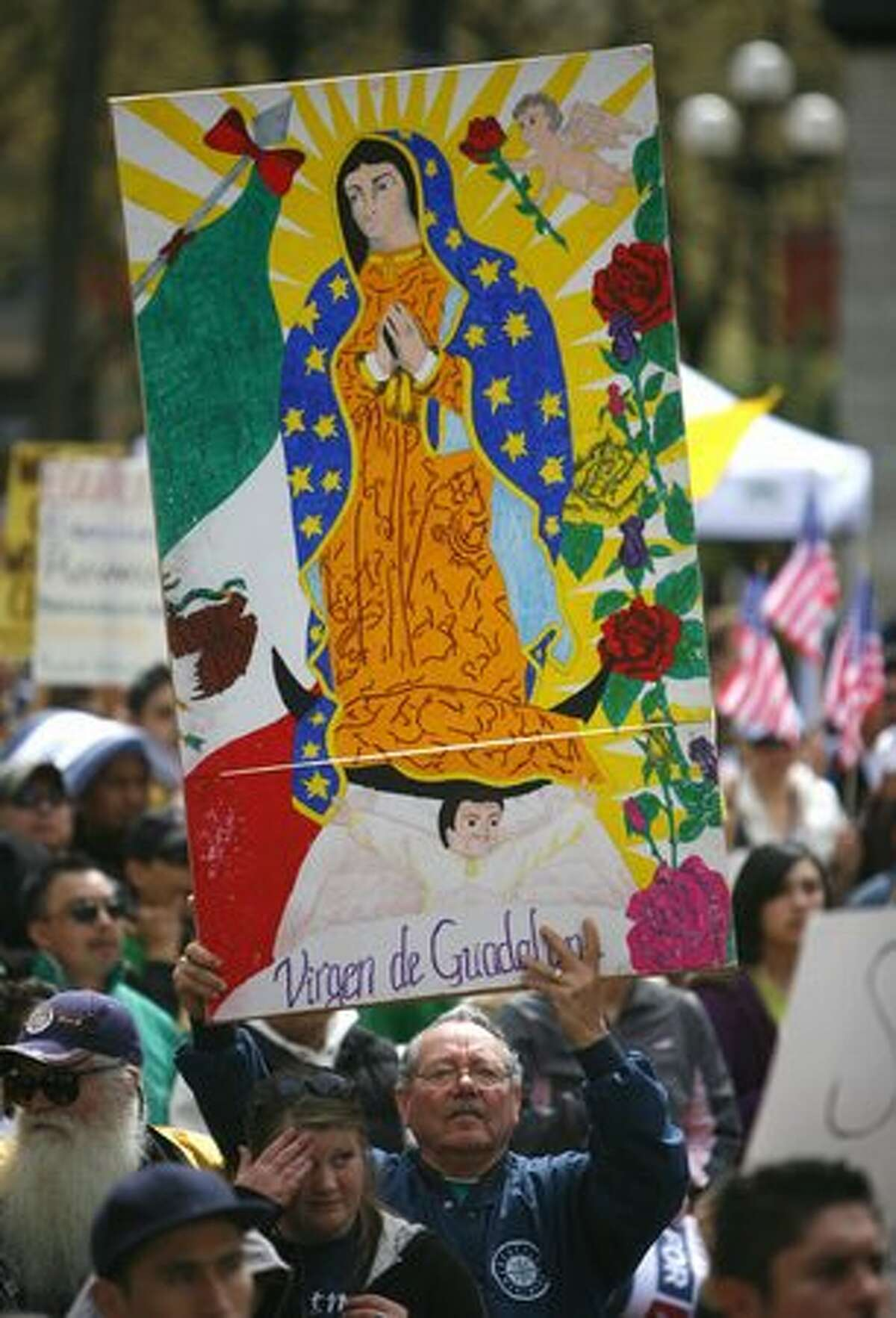 An estimated 7,000 people gather during an immigration reform rally in Seattle's Occidental Park on Saturday April 10, 2010. Speaker Pramila Jayapal, executive director of OneAmerica, said her organization is demanding that a bill be introduced in congress for immigration reform by May 1st.