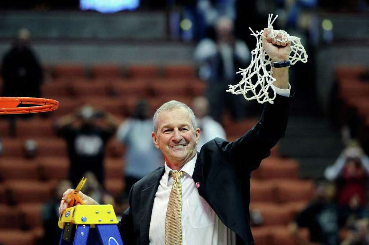 ANAHEIM, CA - MARCH 26: Head coach Jim Calhoun of the Connecticut Huskies cuts down the net after defeatng the Arizona Wildcats to win the west regional final of the 2011 NCAA men's basketball tournament at the Honda Center on March 26, 2011 in Anaheim, California. (Photo by Kevork Djansezian/Getty Images) *** Local Caption *** Jim Calhoun