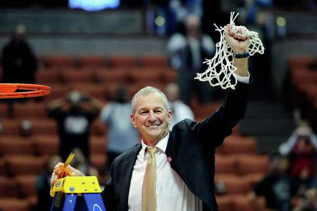 ANAHEIM, CA - MARCH 26:  Head coach Jim Calhoun of the Connecticut Huskies cuts down the net after defeatng the Arizona Wildcats to win the west regional final of the 2011 NCAA men's basketball tournament at the Honda Center on March 26, 2011 in Anaheim, California.  (Photo by Kevork Djansezian/Getty Images) *** Local Caption *** Jim Calhoun Photo: Kevork Djansezian, Getty Images / 2011 Getty Images