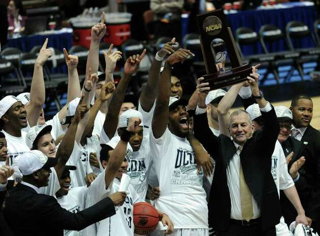 ANAHEIM, CA - MARCH 26:  Head coach Jim Calhoun and the Connecticut Huskies celebrate after defeatng the Arizona Wildcats to win the west regional final of the 2011 NCAA men's basketball tournament at the Honda Center on March 26, 2011 in Anaheim, California.  (Photo by Harry How/Getty Images) *** Local Caption *** Jim Calhoun Photo: Harry How, Getty Images / 2011 Getty Images