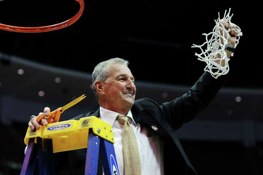 ANAHEIM, CA - MARCH 26:  Head coach Jim Calhoun of the Connecticut Huskies cuts down the net after defeatng the Arizona Wildcats to win the west regional final of the 2011 NCAA men's basketball tournament at the Honda Center on March 26, 2011 in Anaheim, California.  (Photo by Harry How/Getty Images) *** Local Caption *** Jim Calhoun Photo: Harry How, Getty Images / 2011 Getty Images