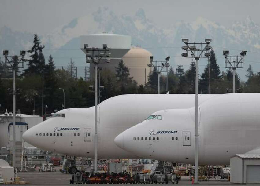 A pair of Boeing 787 Dreamlifters are parked on the Paine Field flight line, in Everett.