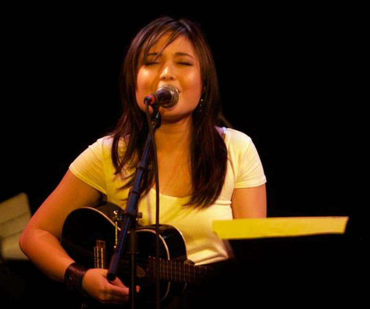 Cristina Bautista of Visqueen performing the group's song Houston at the Tractor Tavern for the