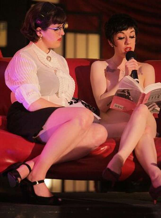 Elsa Von Schmaltz, left, and Polly Wood of Naked Girls Reading share some literature with an audience during the Erotic Art Festival on Friday April 30, 2010 at the Seattle Center Exhibition Hall. Photo: Joshua Trujillo, Seattlepi.com