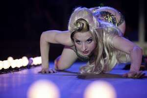 """Performer Inga Ingenue dances during """"Cabaret de Curiosites"""" on the main stage during the Erotic Art Festival on Friday April 30, 2010 at the Seattle Center Exhibition Hall."""