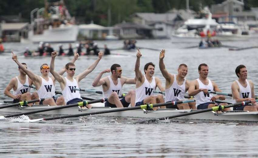 The University of Washington Men's rowing team celebrates after crossing the finish line to secure the 2010 Windermere Cup over Syracuse and Oxford in the Montlake Cut on Saturday May 1, 2010.