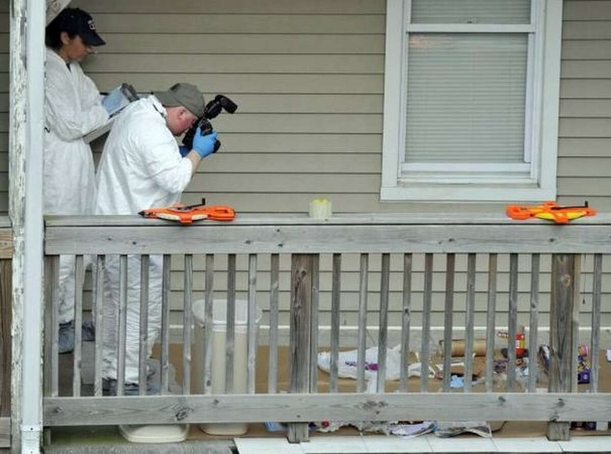 On Tuesday, May 4, 2010, law enforcement work the scene at 202-204 Sheridan St. in Bridgeport, Conn., where Faisal Shahzad lived, as they look for evidence related to the arrest of Shahzad in connection with the attempted bombing in Times Square Saturday night. Shahzad was taken into custody late Monday by FBI agents and New York Police Department detectives while trying to leave the country.