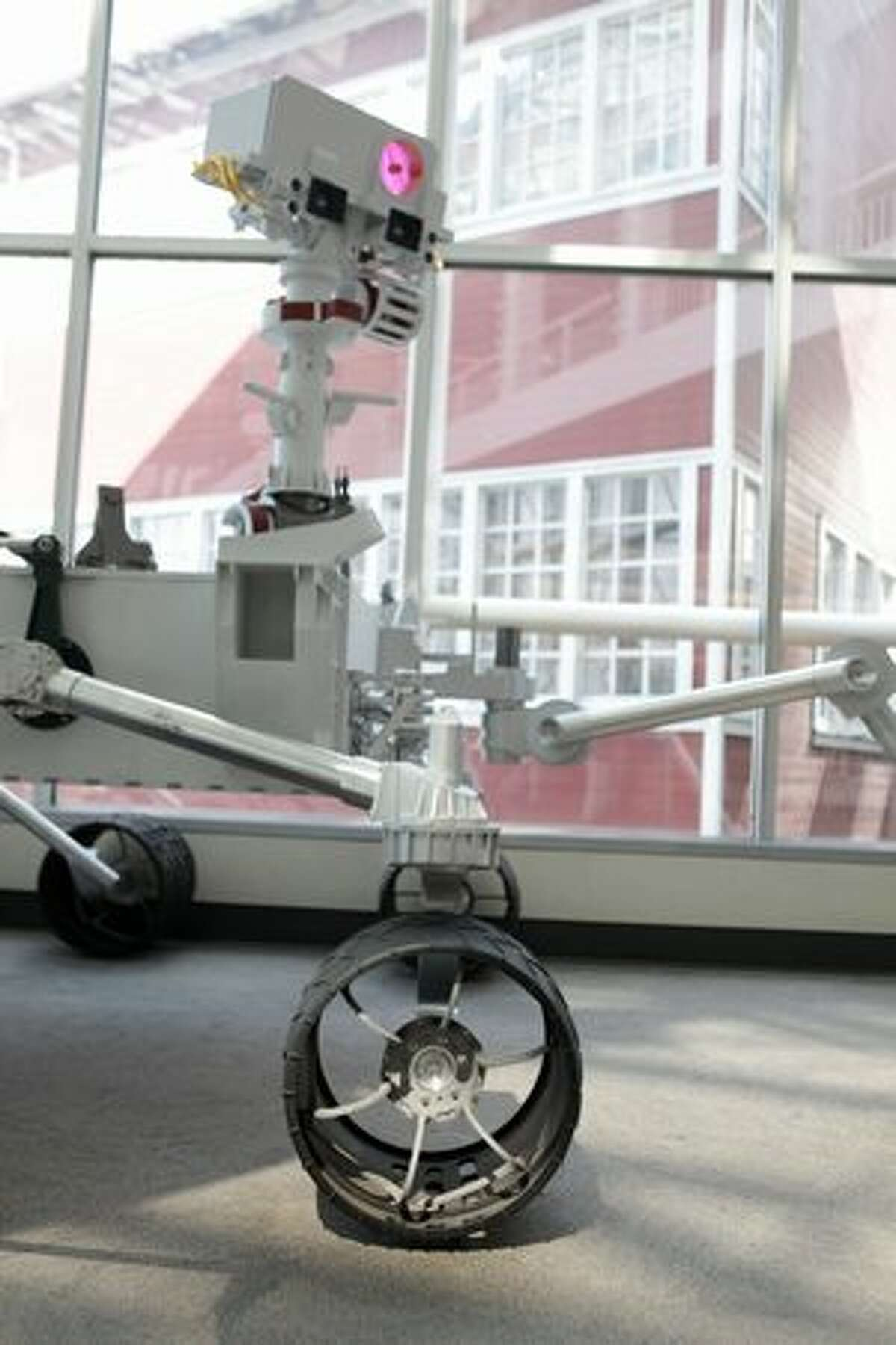 The wheel and camera mast of a full-scale model of NASA's new Mars rover