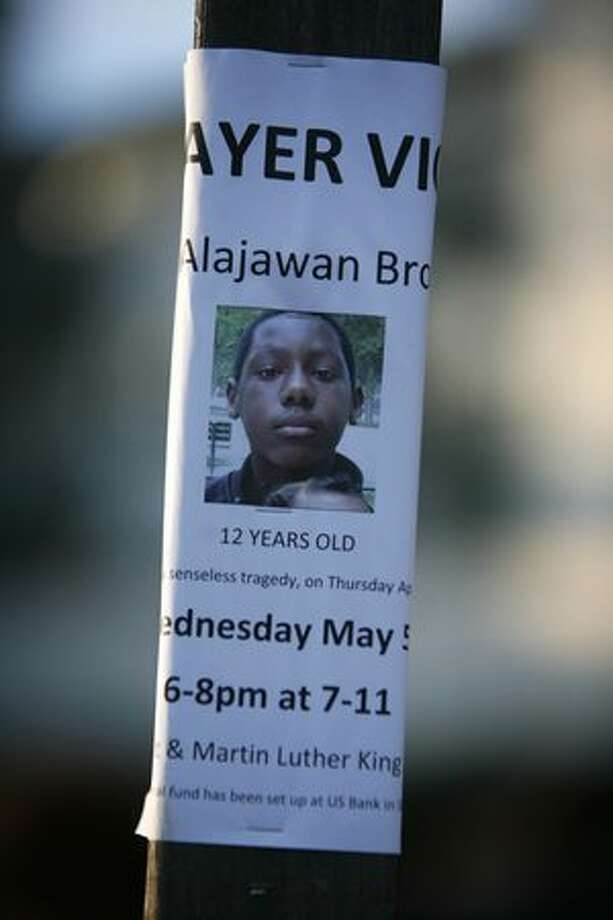 A photograph of Alajawan Brown is shown in the parking lot of a 7-Eleven store on Martin Luther King Way South and South 129th Street in Skyway. Alajawan Brown, a 12 year-old boy, died in the parking lot of the convenience store on April 29 when he was shot after getting off the bus. Photo: Joshua Trujillo, Seattlepi.com