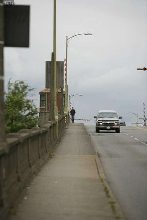 A pedestrian walks along the South Park Bridge on Wednesday. Photo: Joshua Trujillo, Seattlepi.com