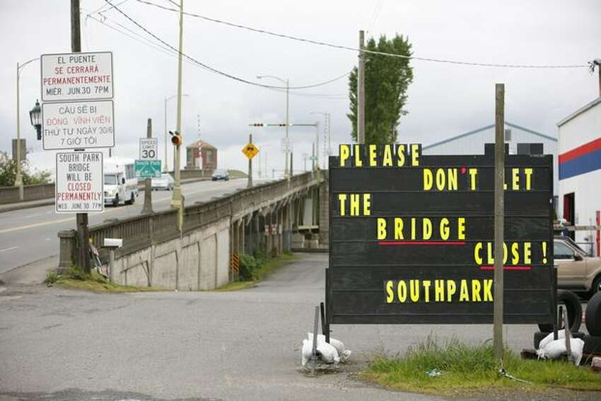 A sign shares the sentiment of the South Park community as the bridge that leads into the heart of the business district will be closed permanently.