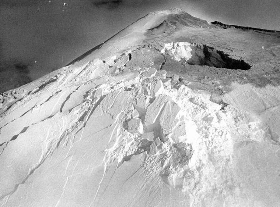 The small eruption at the top of Mount St. Helens raised fears that heat from the volcano would quickly melt the winter snows, which proved to be true. March 26, 1980 (Photo by Grant Haller) Photo: P-I File
