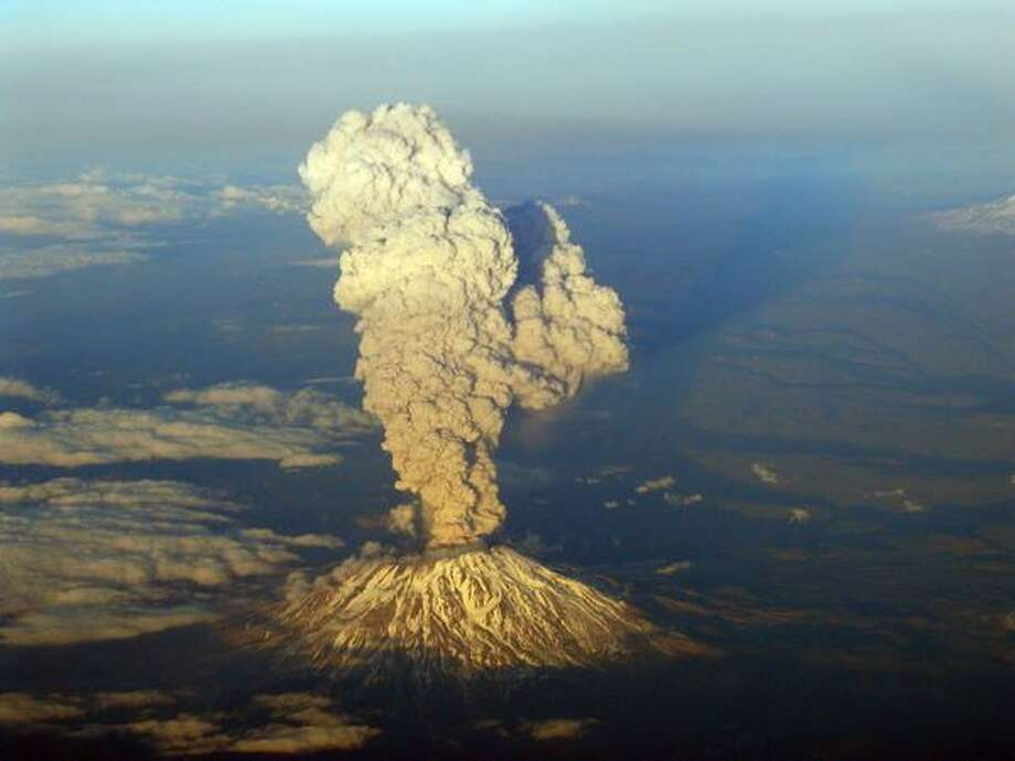 A view from a commercial aircraft shows Mount St. Helens erupting on Tuesday March 8, 2005. (Photo by Terry McClain) Photo: P-I File