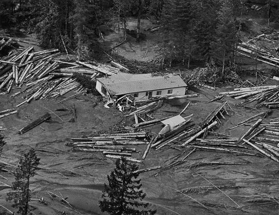 A house was washed down the North Fork of the Toutle River after Mount St. Helens erupted on May 18, 1980. A huge mud flow caused a number of houses to be carried away and wash up on the banks of the river. (Photo by Grant Haller) Photo: P-I File