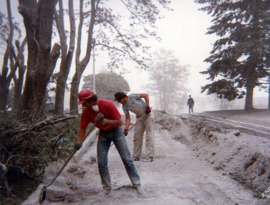 People begin to clear W. Broadway in Ritzville of ash from Mount St. Helens. This picture was made just after the eruption on May 18, 1980 (Photo by Terry Janzen) Photo: P-I File