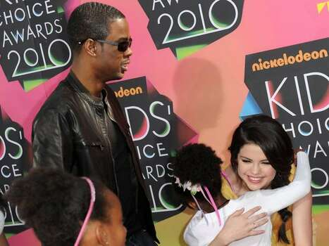 LOS ANGELES, CA - MARCH 27: Actor/comedian Chris Rock (L) and actress Selena Gomez arrive at Nickelodeon's 23rd Annual Kid's Choice Awards held at UCLA's Pauley Pavilion on March 27, 2010 in Los Angeles, California. Photo: Getty Images