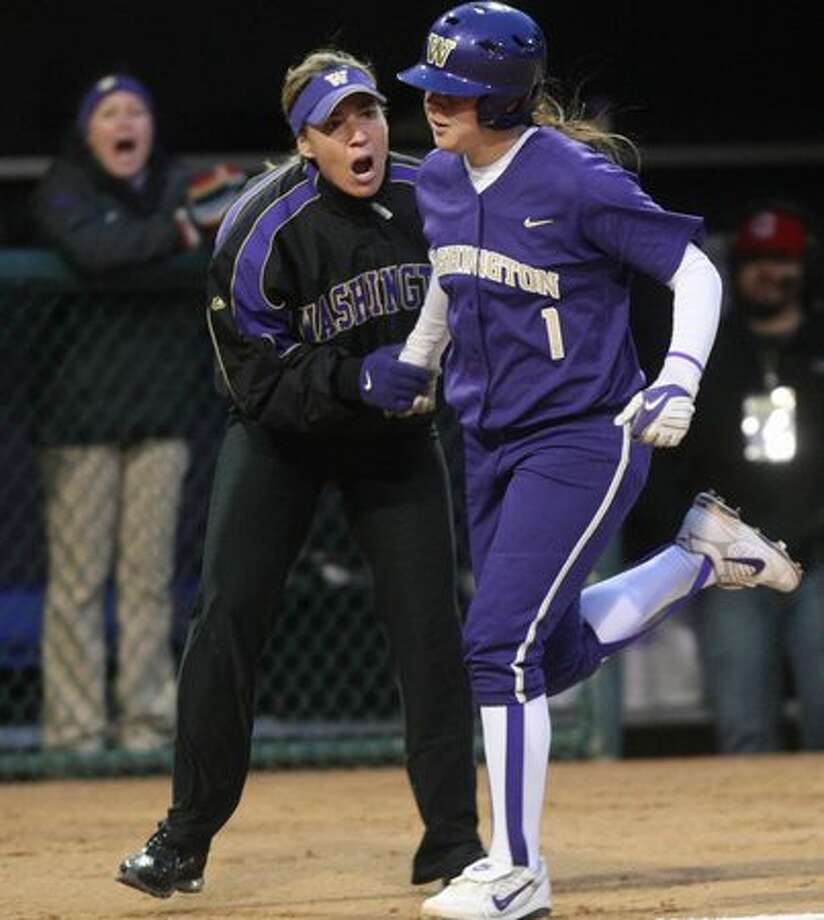 University of Washington player Shawna Wright rounds third base and celebrates with head coach Heather Tarr after Wright hit a home run against the University of Oklahoma during the third in a series of games in the NCAA Super Regionals on Friday May 28, 2010 at Husky Stadium. Photo: Joshua Trujillo, Seattlepi.com