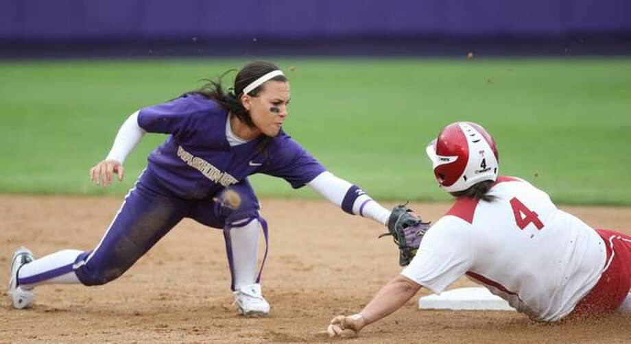 University of Washington player Jenn Salling misses the tag on University of Oklahoma player Amber Flores for a stolen base during the NCAA Super Regionals on Friday, May 28, 2010, at Husky Stadium. The Huskies defeated the Sooners 3-0. Photo: Joshua Trujillo, Seattlepi.com