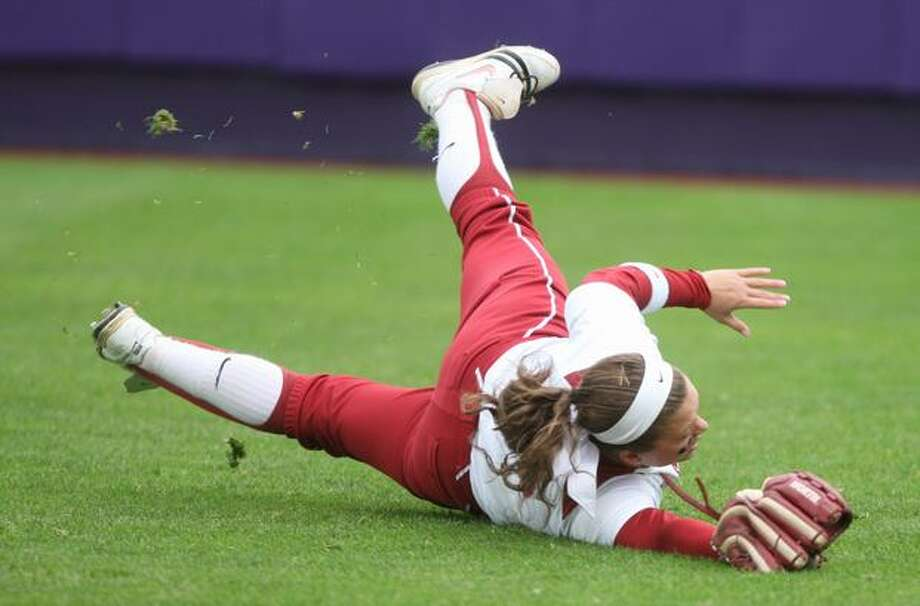 University of Oklahoma player Haley Nix dives as a Husky hit gets past her during the NCAA Super Regionals on Friday, May 28, 2010, at Husky Stadium. The Huskies defeated the Sooners 3-0. Photo: Joshua Trujillo, Seattlepi.com