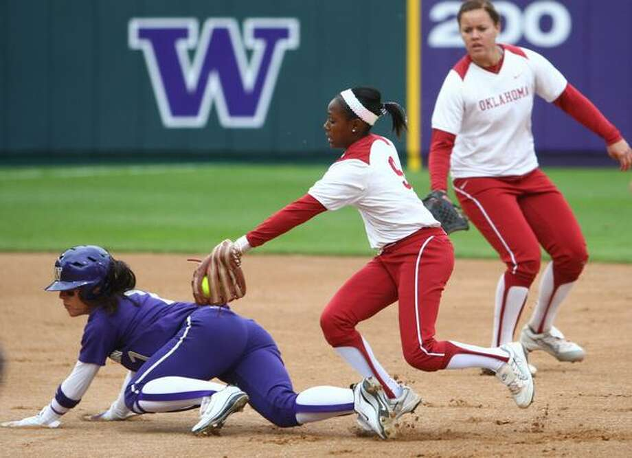 University of Washington player Jenn Salling dodges a tag from University of Oklahoma player Krystle Huey dduring the NCAA Super Regionals on Friday, May 28, 2010, at Husky Stadium. The Huskies defeated the Sooners 3-0. Photo: Joshua Trujillo, Seattlepi.com