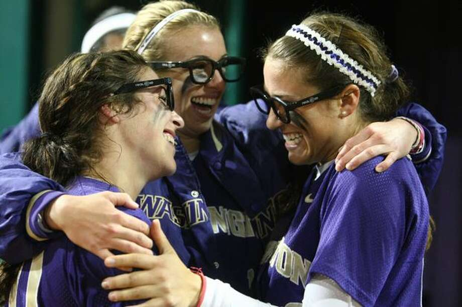 University of Washington players, from left, Bailey Stenson, Jenna Clifton and Maggie Wagner celebrate after defeating the University of Oklahoma during the third in a series of games in the NCAA Super Regionals on Friday May 28, 2010 at Husky Stadium. Photo: Joshua Trujillo, Seattlepi.com